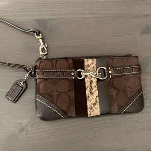 Coach wristlet with logo and leather accents